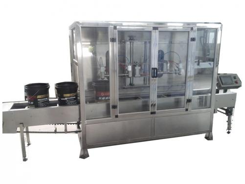 Liquid weighting and filling machine