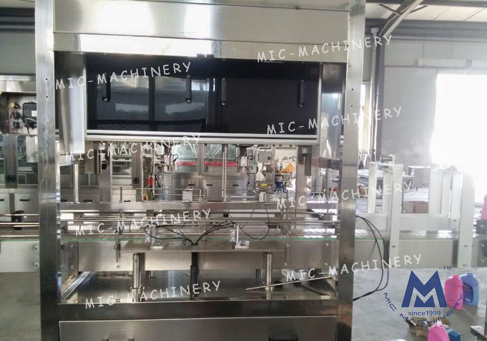 MIC- Automatic in-line catch cap machine